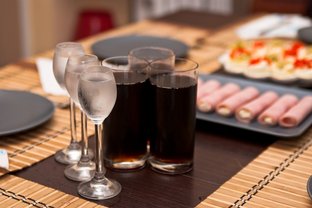 three glasses with cold vodka and three glasses of cola