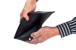 Elderly hands holding an empty wallet isolated